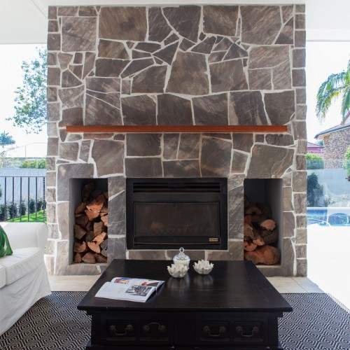 QH Loves: Five Chic Fireplaces That'll Keep You Warm This Winter