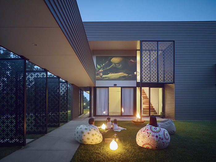 Courtyard at night - The Bird House by Jamison Architects