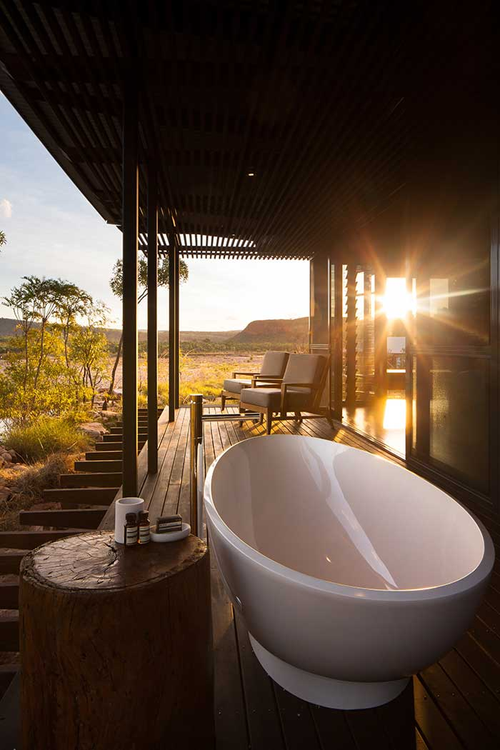 Create an outdoor bathroom with these gorgeous volcanic limestone ...