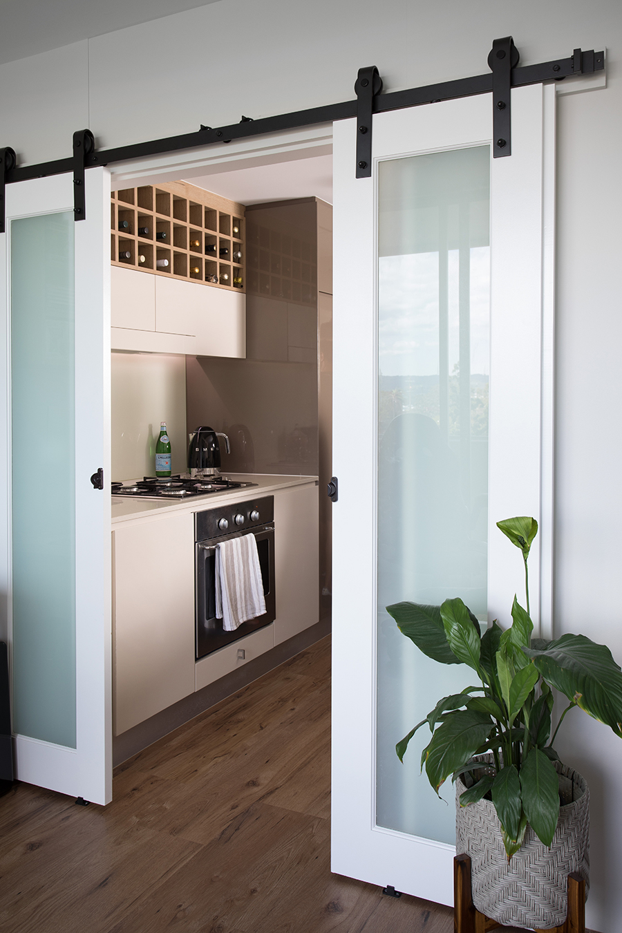 Ivy + Finch apartment interior design sliding door