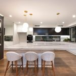 This stunning kitchen space showcases the natural beauty of stone
