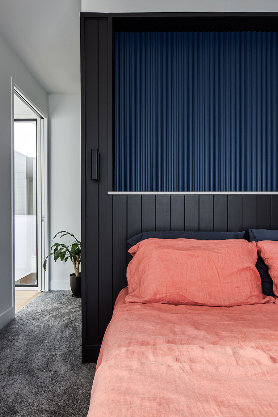 SMITH Architects modern family home coloured paneling bedhead